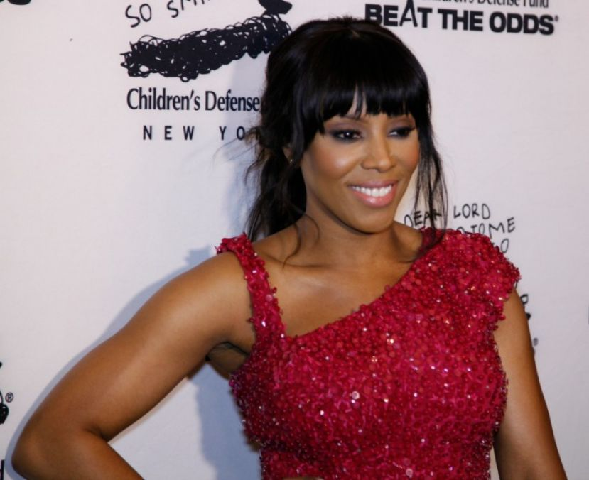 Celebrity fashion stylist, June Ambrose, on the red carpet at the Children's Defense Fund's annual gala.