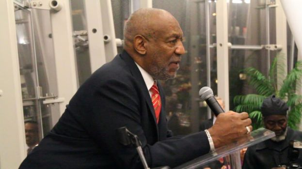 Bill Cosby speaking to an audience at Medgar Evers College in Brooklyn, NY
