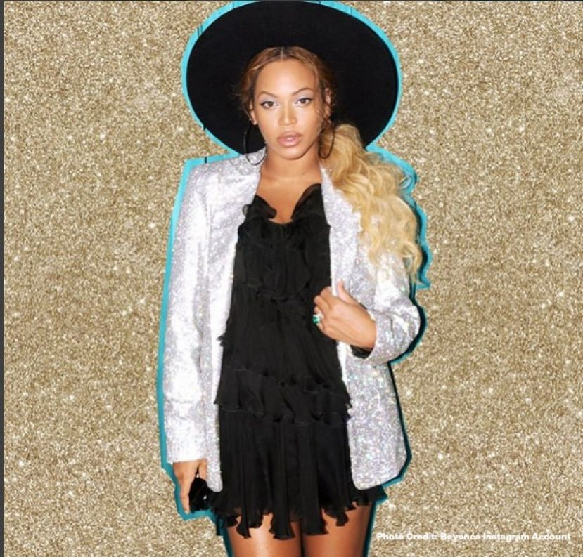 Beyonce, pregnant with twins, showing off her pregnancy style.