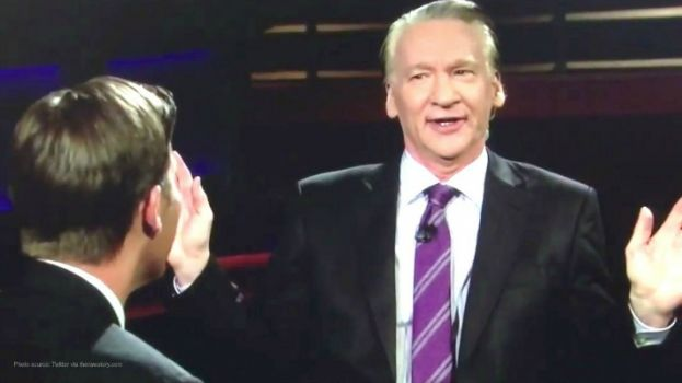 Bill Maher (facing) on the set of his show, Real Time with Bill Maher, talking with US Senator Ben Sasse.