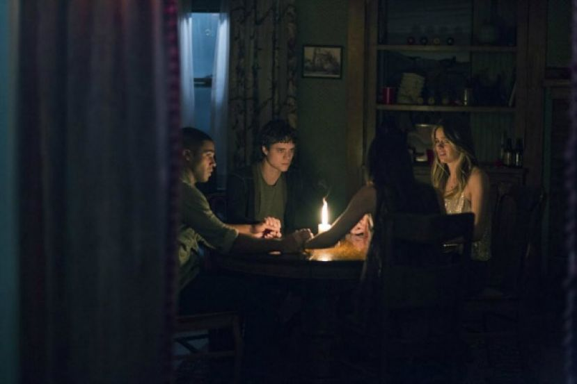 Photo From left to right: Lucien Laviscount, Douglas Smith, Cressida Bonas, and Jenna Kanell, the cast of The Bye, Bye Man at a séance.