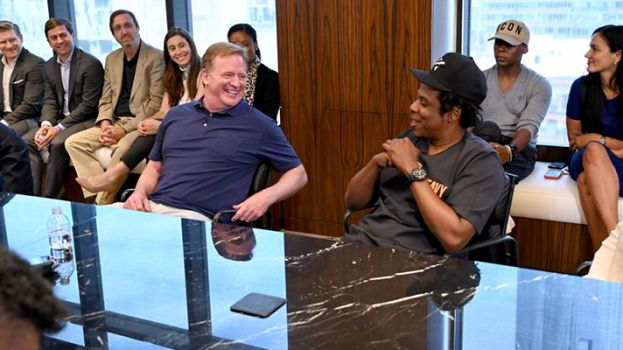NFL commissioner, Roger Goodell (left), with hip-hop business mogul, Jay Z, announcing Jay Z's company's partnership with the NFL.