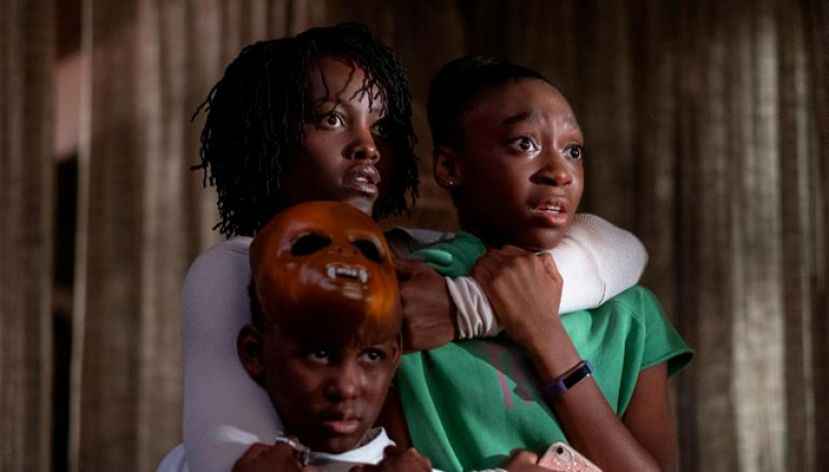 Lupita Nyong'o as Adelaide Wilson, in the movie Us, directed by Jordan Peele, holds onto her two children played by Shahadi Wright Joseph and Evan Alex.