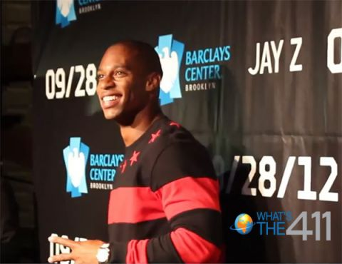 New York Giants wide receiver Victor Cruz on the red carpet at the grand opening of the Barclays Center acknowledging the fans as he makes way to speak with What's The 411 co-host Barbara Bullard.