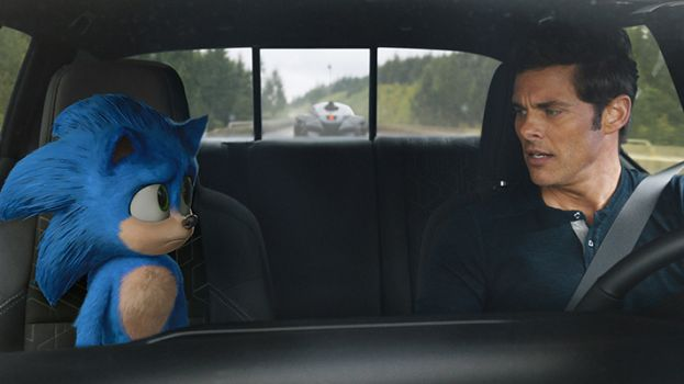 Actor James Marsden driving a car talking with the Hedgehog, who is a passenger in the vehicle.