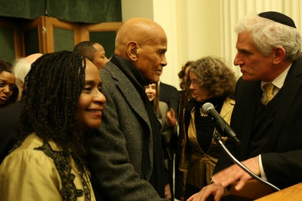 Dr. Brenda M. Greene, Executive Director, Center for Black Literature at Medgar Evers College (CUNY); and co-sponsor of opening reception of Stephen Somerstein's photo exhibit commemorating the 1965 Selma to Montgomery Civil Rights March, standing next to singer, songwriter, actor, and social activist Harry Belafonte, keynote speaker for the reception