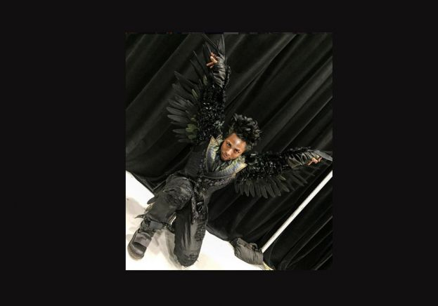 Performance artist Olutayo in his crow costume from The Wiz Live!