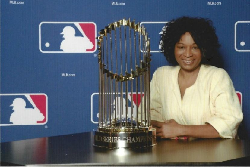 Ruth J. Morrison with Major League Baseball's World Series trophy