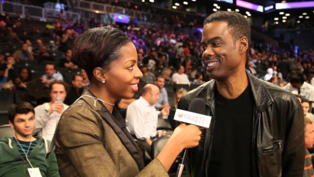What's The 411Sports correspondent Crystal Lynn talking with actor/comedian Chris Rock during halftime at a 2013 Brooklyn Nets vs. Miami Heat game