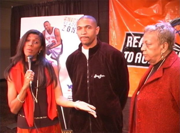 Amelia Moore, What's The 411 co-host, interviewing New York Knicks guard Mark Jackson, and his mother at the New York Knicks Reading Zone celebration at Madison Square Garden