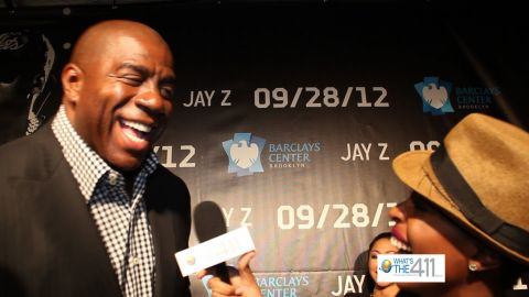 "Earvin ""Magic"" Johnson talking with Crystal Lynn on the red carpet at the opening of the Barclays Center"